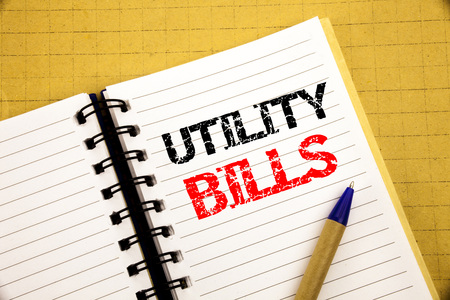 Utility Bills. Business concept for Money Bill Payment written on notepad with space on old wood wooden background with pen marker