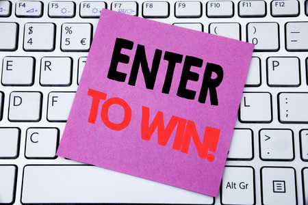 Handwriting Announcement text showing Enter to Win. Business concept for Winning in Competition written on sticky note paper on white keyboard background. Stock Photo