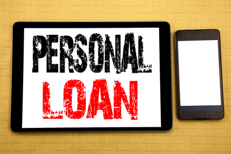 Hand writing text caption inspiration showing Personal Loan. Business concept for Bank Financial Help Written on tablet, wooden background with sticky note and pen Stock Photo