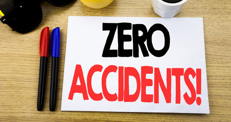 Handwritten text caption showing Zero Accidents. Business concept writing for Safety At Work Hazard written on sticky note with copy space old wood wooden background with sunglasses