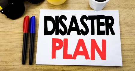Handwritten text caption showing Disaster Plan. Business concept writing for Emergency Recovery written on sticky note with copy space old wood wooden background with sunglasses