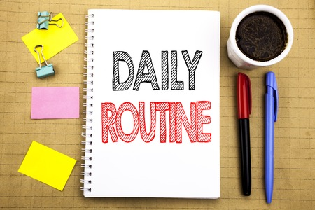 Word, writing Daily Routine. Business concept for Habitual Lifestyle Written on notepad paper background with space office view with pencil marker coffee Stockfoto