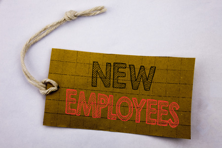 Handwriting Announcement text showing New Employees. Business concept for online sale Welcome Staf Recruiting written on price tag paper on white vintage background. Banco de Imagens