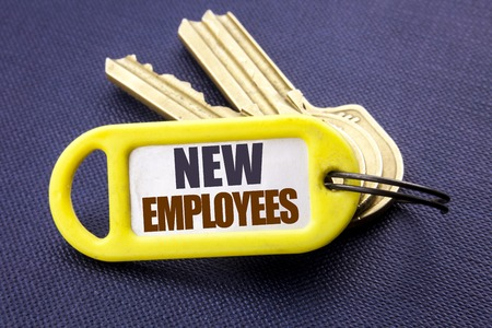Handwriting Announcement text showing New Employees. Business concept for Welcome Staf Recruiting Written key holder note black background with space close up