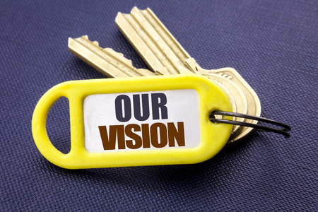 Handwriting Announcement text showing Our Vision. Business concept for Marketing Strategy Vision Written key holder note black background with space close up