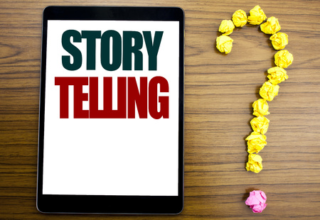 Word, writing Storytelling. Business concept for Teller Story Message Written on tablet, background with question mark on the end. Stock Photo