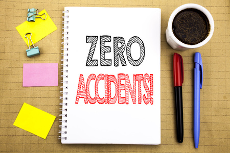 Word, writing Zero Accidents. Business concept for Safety At Work Hazard Written on notepad paper background with space office view with pencil marker coffee Foto de archivo