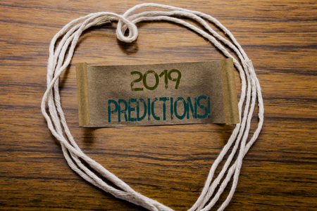 Conceptual hand writing text caption 2019 Predictions. Business concept for Forecast Predictive written on sticky note paper on dark wooden background. With heart meaning love or adoration. Stock fotó