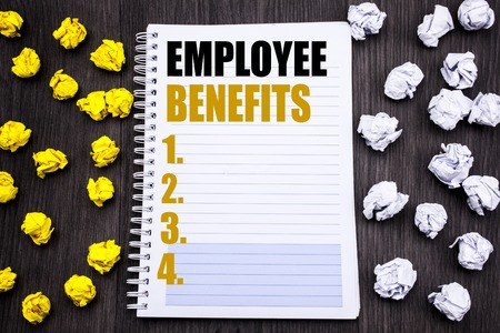 Conceptual hand writing text caption showing Employee Benefits. Business concept for Compensation Career Written notepad note notebook book wooden background with sticky folded yellow and white Imagens