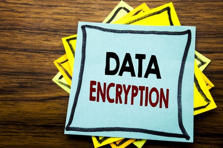 Hand writing text caption inspiration showing Data Encryption. Business concept for Information Security written on sticky note paper on wooden wood background.
