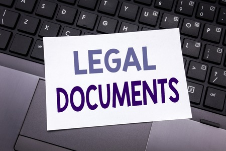 Hand writing text caption inspiration showing Legal Documents. Business concept for Contract Document written on sticky note paper on black keyboard background.