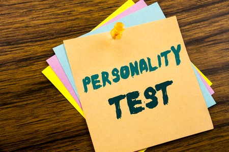 Hand writing text caption inspiration showing Personality Test. Business concept for Attitude Assessment written on sticky note paper on wooden background. Фото со стока