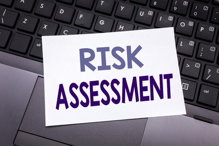 Hand writing text caption inspiration showing Risk Assessment. Business concept for Safety Danger Analyze written on sticky note paper on black keyboard background. Stock Photo