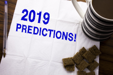 Hand writing text caption showing 2019 Predictions. Business concept for Forecast Predictive written on tissue paper on wooden background with pen and healthy coffee in the restaurant