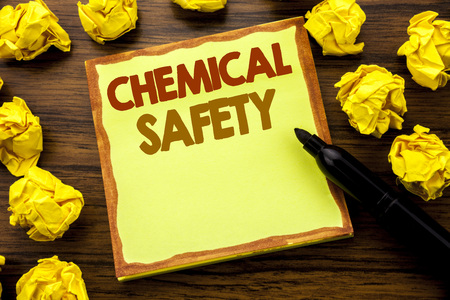 Hand writing text caption showing Chemical Safety. Business concept for Hazard Health At Work Written on sticky note paper, wooden background marker folded yellow paper meaning thinking