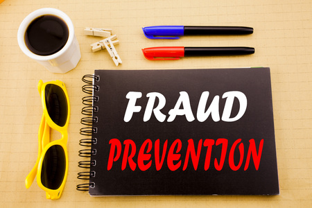 Hand writing text caption showing Fraud Prevention. Business concept for Crime Protection written on sticky note with copy space on wood wooden background with sunglasses Banque d'images