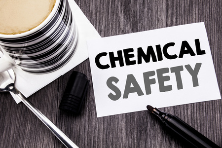 Handwriting Announcement text showing Chemical Safety. Business concept for Hazard Health At Work written on sticky note paper on wooden wood background. With marker and coffee. Office top view. Stock Photo