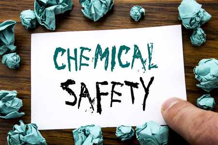 Handwriting Announcement text showing Chemical Safety. Business concept for Hazard Health At Work Written on sticky note paper, wooden background folded yellow paper meaning thinking