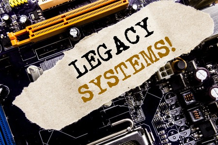Handwriting Announcement text showing Legacy Systems. Business concept for Upgrade SOA Application Written on sticky, computer main board background.
