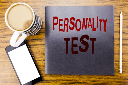 Handwriting Announcement text showing Personality Test. Business concept for Attitude Assessment Written on notepad note paper, wooden wood background coffee pen and cellphone phone Фото со стока