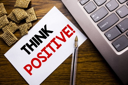 Handwriting Announcement text showing Think Positive. Business concept for Positivity Attitude written on sticky note paper on wooden background next to the laptop keyboard
