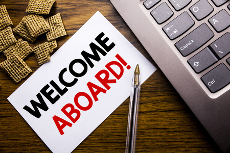 Handwriting Announcement text showing Welcome Aboard. Business concept for Greeting Join Member written on sticky note paper on wooden background next to the laptop keyboard