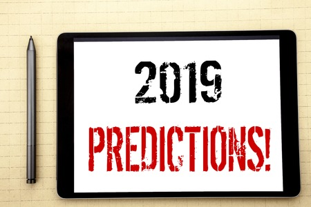 Handwritten text showing 2019 Predictions. Business concept writing for Forecast Predictive Written on tablet computer screen, white background office space view with pencil marker