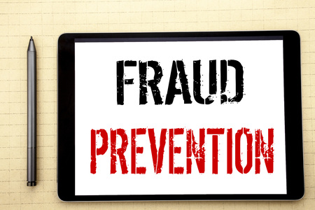 Handwritten text showing Fraud Prevention. Business concept writing for Crime Protection Written on tablet computer screen, white background office space view with pencil marker Stock Photo