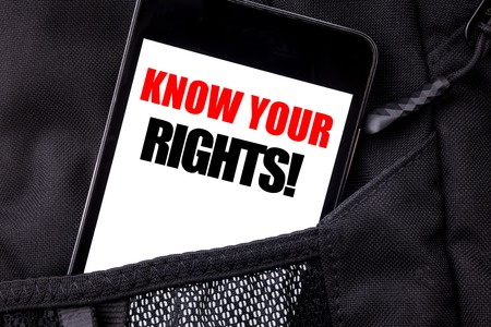 Handwritten text showing Know Your Rights. Business concept writing for Justice Education Written phone mobile phone, cellphone placed in  man front jeans pocket.