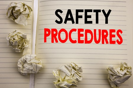 Handwritten text showing Safety Procedures. Business concept writing for Accident Risk Policy Written on notepad paper, white background with space and office view. Archivio Fotografico