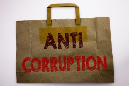 Word, writing Anti Corruption. Business concept for Bribery Corrupt Text Written shopping bag, white isolated background.