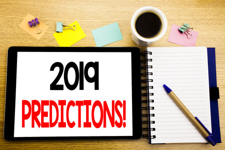Word, writing 2019 Predictions. Business concept for Forecast Predictive Written on tablet, wooden background with sticky note and pen Stock fotó
