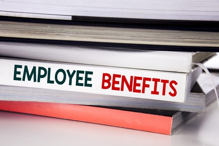 Word, writing Employee Benefits. Business concept for Compensation Career written on the book the white background. Imagens