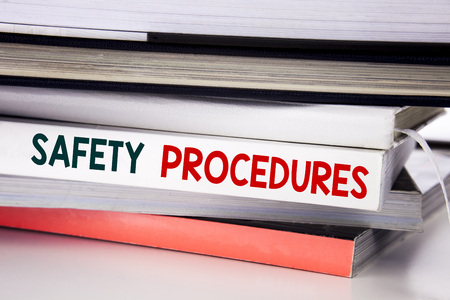 Word, writing Safety Procedures. Business concept for Accident Risk Policy written on the book the white background. Banque d'images