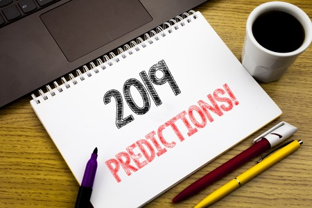Writing text showing 2019 Predictions. Business concept for Forecast Predictive written on notebook book on wooden background in the Office with laptop Stock Photo