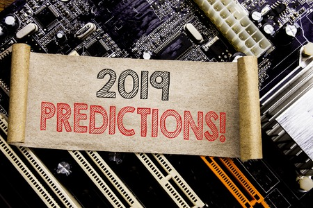 Writing text showing 2019 Predictions. Business concept for Forecast Predictive Written on sticky, computer main board background.