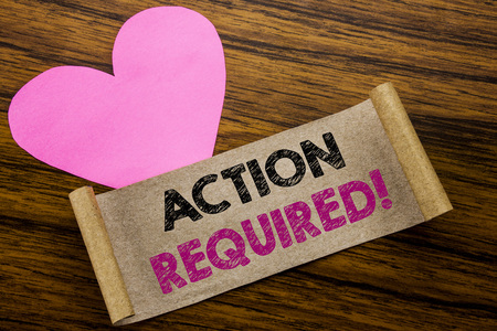 Writing text showing Action Required. Business concept for Immediate Urgent written on sticky note paper, wooden background. With pink heart meaning love adoration.