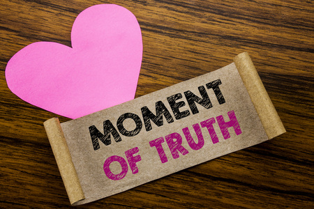 Writing text showing Moment Of Truth. Business concept for Hard Decision Pressure written on sticky note paper, wooden background. With pink heart meaning love adoration.