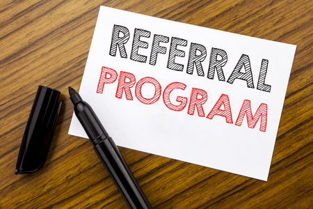 Writing text showing Referral Program. Business concept for Refer Marketing  written on sticky note paper on wooden background with pen, marker