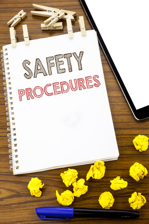 Writing text showing Safety Procedures. Business concept for Accident Risk Policy written on note paper folded Meaning Thinking paper on the wooden background with marker and coffee
