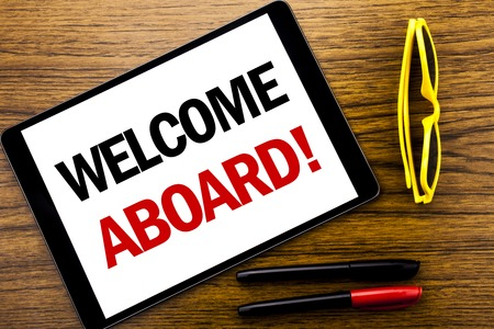 Writing text showing Welcome Aboard. Business concept for Greeting Join Member Written tablet laptop, wooden background with vacation yellow glasses and marker pen. 版權商用圖片 - 96795324