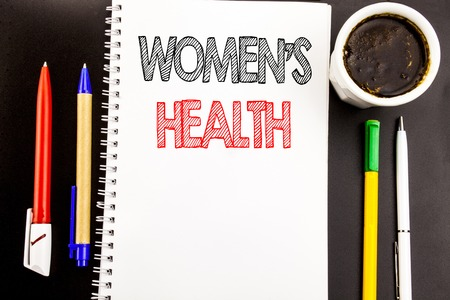 Writing text showing Women's Health. Business concept for Female Celebration Written on notepad paper background with space office view with pencil marker coffee Standard-Bild
