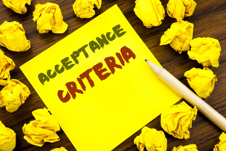 Word, writing Acceptance Criteria. Business concept for Digital Criterion Written on sticky note paper, wooden background folded yellow paper meaning thinking