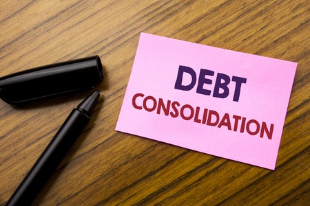 Word, writing Debt Consolidation. Business concept for Money Loan Credit Written on sticky note red paper, wooden background pen. Note stick on the desk. Stock Photo