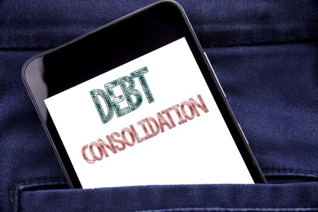 Handwriting Announcement text showing Debt Consolidation. Business concept for Money Loan Credit Written phone mobile phone, cellphone placed in man front jeans pocket. 스톡 콘텐츠