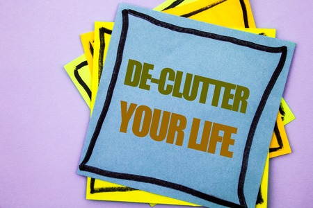 Writing text showing  De-Clutter Your Life. Business photo showcasing Free Less Chaos Fresh Clean Routine written sticky note paper the pink background.