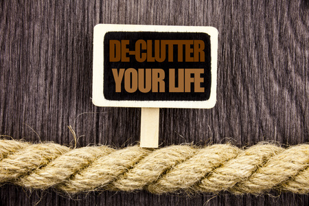 Conceptual writing text showing De-Clutter Your Life. Business photo showcasing Free Less Chaos Fresh Clean Routine written Blackboard Hanging rope wooden background