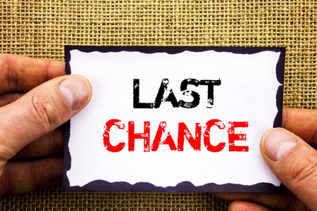 Writing text showing  Last Chance. Concept meaning Announcement Alert Time or Deadline Ending written Sticky Note Paper Holding Hand with Finger. Stok Fotoğraf