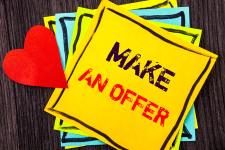Writing text showing  Make An Offer. Concept meaning Settlement Negotiation With Agent Agency Over Home  written Stikcy Note Paper the wood background Love Heart Stock Photo