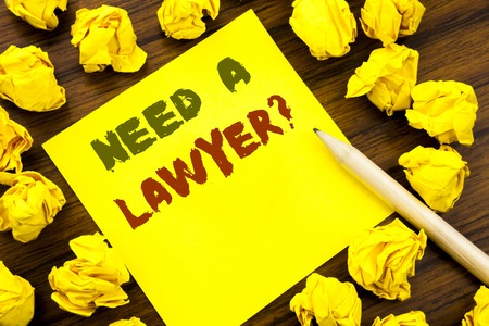 Word, writing Need A Lawyer. Business concept for Advocacy Justice Help Written on sticky note paper, wooden background folded yellow paper meaning thinking Stock Photo
